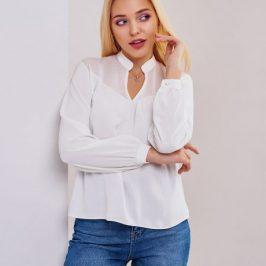 Мода на білий колір в жіночому одязі.